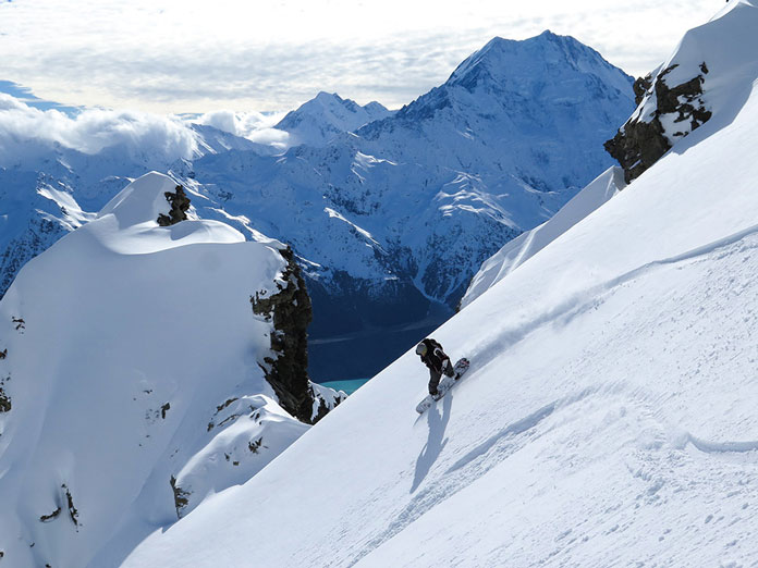 Snowboarding a spectacular steep line with Mt Cook Heliski New Zealand