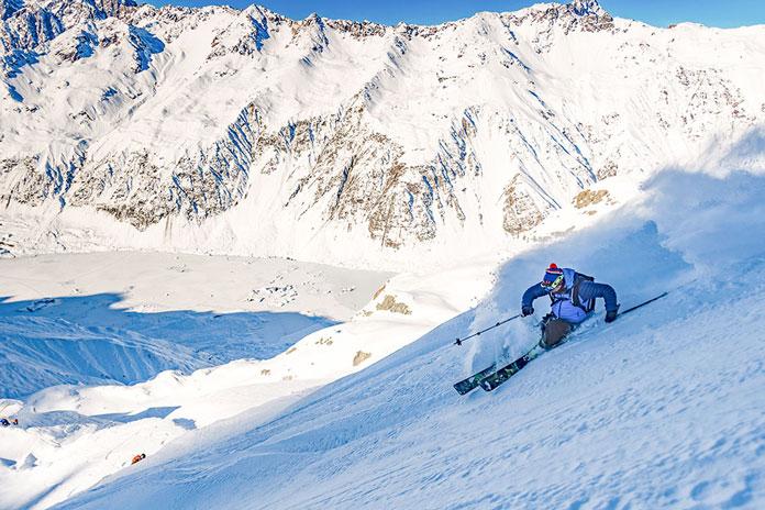 Skier slashing powder with Mt Cook Heliski New Zealand