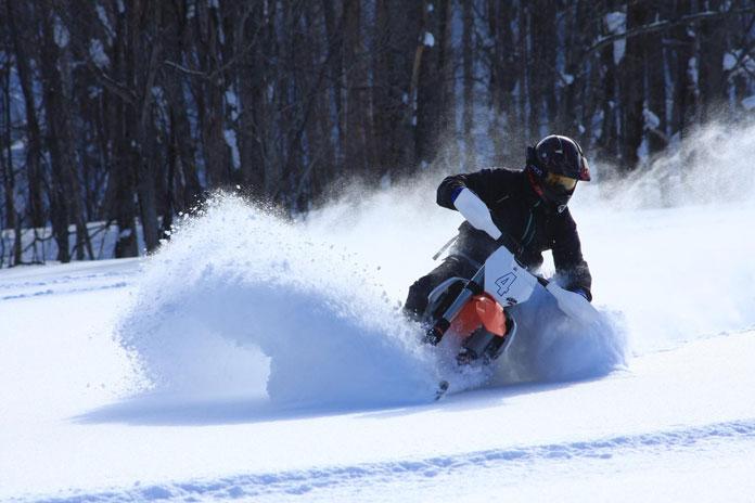 Slashing through deep snow with Hokkaido Snow Bikes