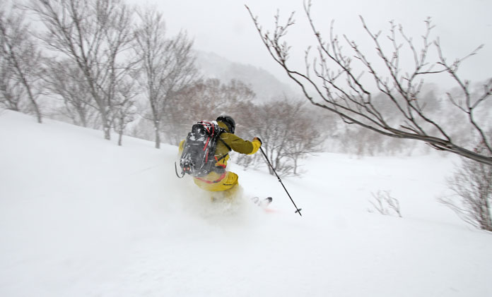 Boss Kuragane owner and chief guide with Hachimantai Cat Skiing leads the way in the powder on Mt Chausu