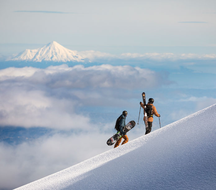 Hiking Turoa at Mt Ruapehu with a view to Mt Taranaki/Mt Egmont