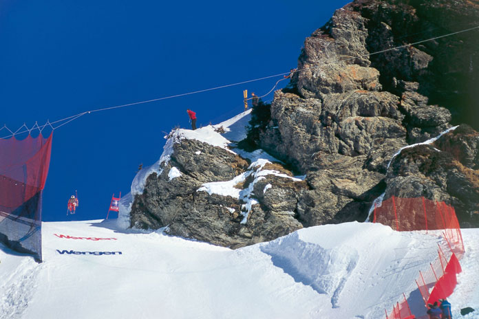Racer gets air at the Hundschopf during the Lauberhorn World Cup race