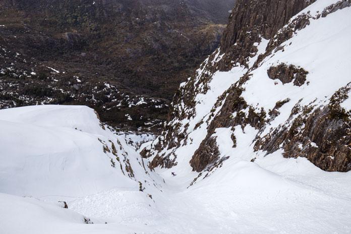 Skiing steep Cradle Mountain couloir, Tasmania