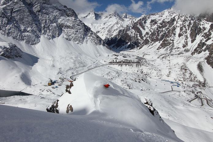 Snowboarding steep powder off Roca Jack lift at Portillo