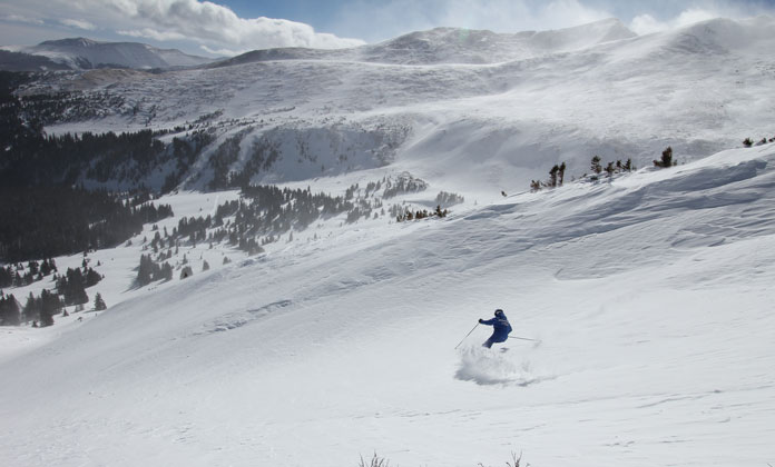 Skiing powder off Peak 8 at Breckenridge