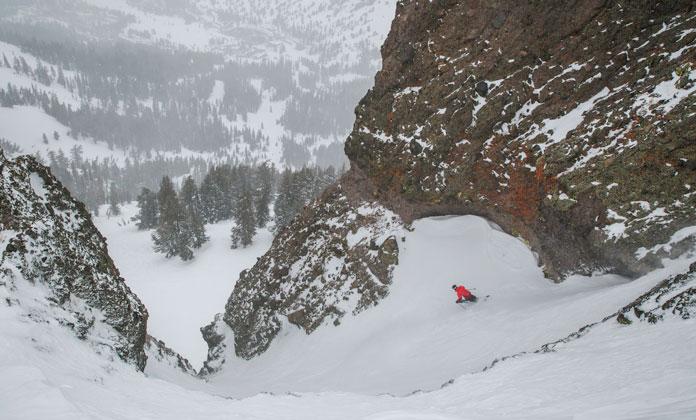 Skier dropping into chute at Kirkwood Ski Area