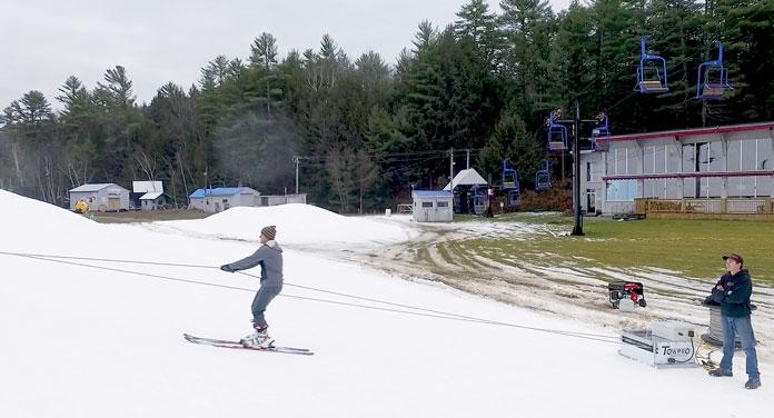 Skier riding a Towpro portable ski lift