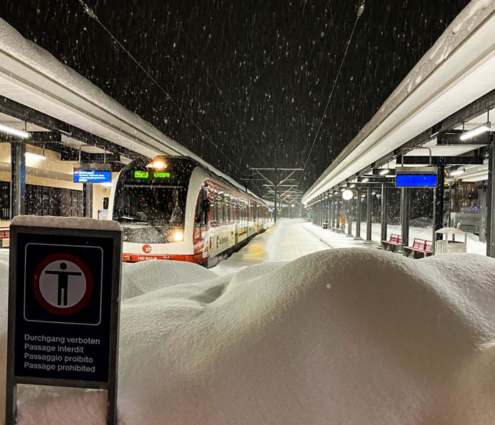 Engelberg Station at night with snow falling