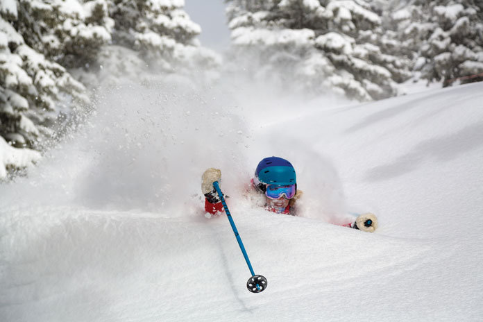 Jess McMillan up to her neck in fresh powder at Jackson Hole
