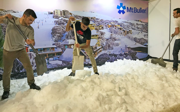 Shovelling snow at the Melbourne Snow Travel Expo