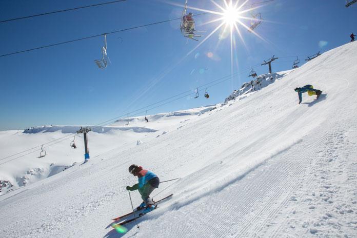 Skiing the wide opened piste at Turoa, Mt Ruapehu