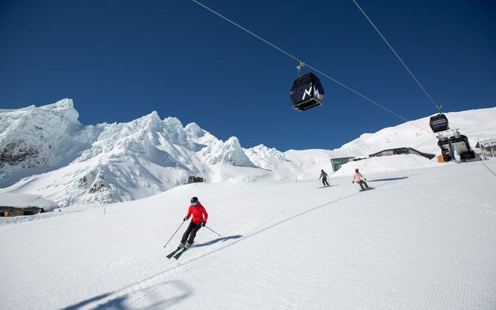 Skiing beneath the Sky Whaka at Mt Ruapehu