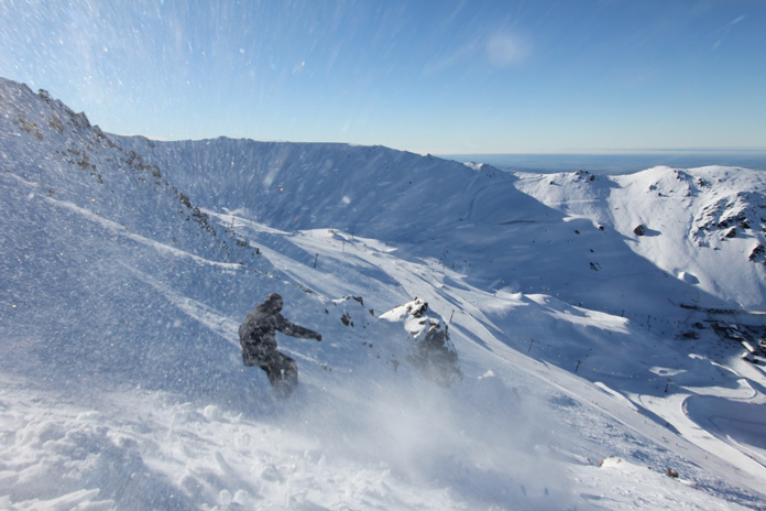 Snowboarder early season in Towers at Mt Hutt