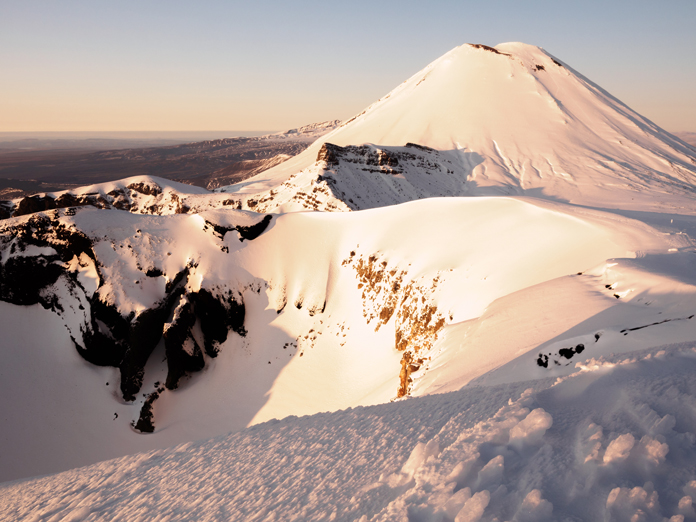 View of Nguarahoe in winter on Tongariro Crossing guided walk