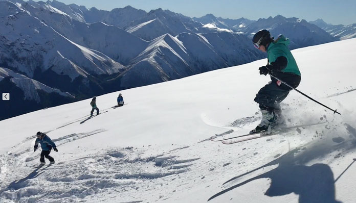 Skiing powder in the back bowl at Ohau ski field with a view to Aoraki / Mt Cook