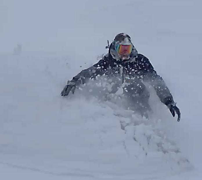 Snowboarding waste deep snow, August 24 2021 at Thredbo