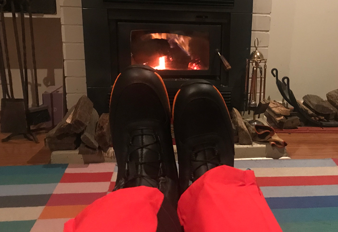 Dahu inner boots put on in front of fire for day trip