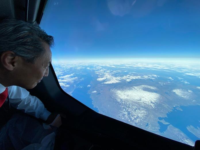 Crew member checks the view on Qantas Buenos Aires Darwin direct flight
